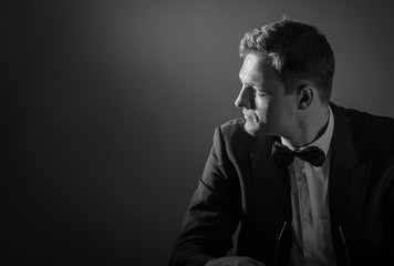 Dramatic studio portrait of a man. Black & white photo