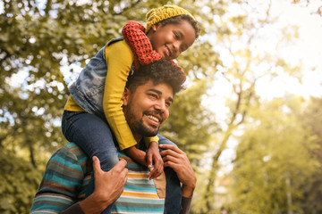 African American father with daughter on meadow. Wall mural
