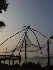 Chinese fishing net at sunset in Kochi