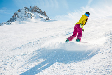 Picture of sports woman snowboarding on snowy slope