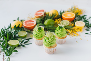 spring cupcake on a white background with flowers and fruits aro