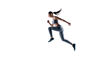 Side profile view full size full length portrait of sporty energetic serious healthy dynamic sportswoman frozen in motion, she is in running pose, isolated on white background, copyspace
