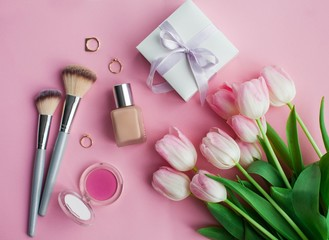 Cosmetics, decorations, a bouquet of tulips on a pink background. Gift. A box with a gift. International Women's Day. Holidays. Spring.