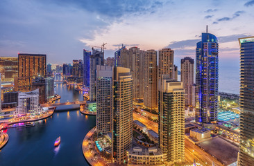 Dubai Marina aerial view by night. United Arab Emirates. Scenic skyline.