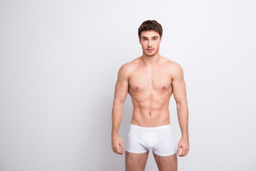 Portrait of neat sportive athletic stunning attractive with perfect body sportsman with six-pack huge muscles wearing white classic underpants isolated on white background copy-space