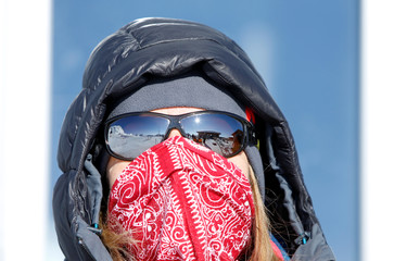 A woman is pictured on top of highest German mountain, the Zugspitze, in Garmisch-Partenkirchen