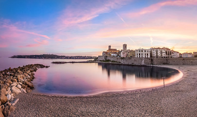 Fototapete - Panoramic view of Antibes on sunset from Plage de la Gravette, French Riviera, France