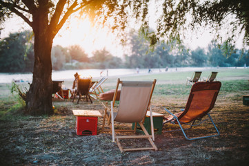 Romantic outdoor nature setting. Pair of chairs and a beautiful sunset
