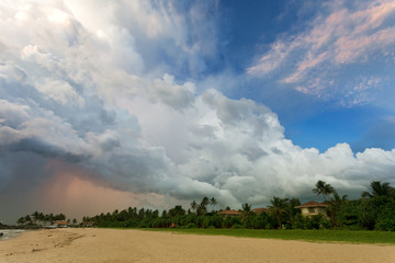 Ahungalla Beach, Sri Lanka - Huge clouds and various light during sunset at the beach of Ahungalla