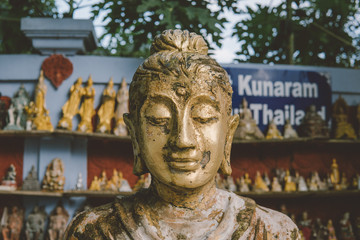 Buddha statue as amulets of Buddhism religion close-up. Old Buddha face