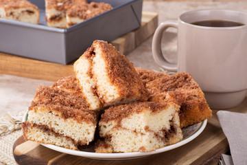 Pile of cinnamon swirl coffee cake on a plate