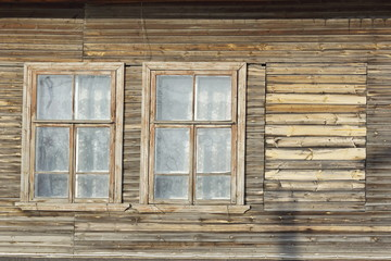 the windows of an old wooden dilapidated house. social problem.