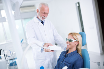 Dentist prepares a teeth whitening device