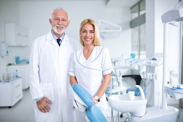 Two smiling dentists in a dental office