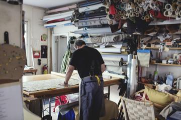 Man working in textile workshop