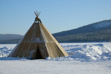 Winter polar landscape with eskimo tent.