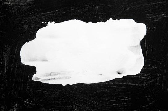 white grunge brush strokes paint on black background