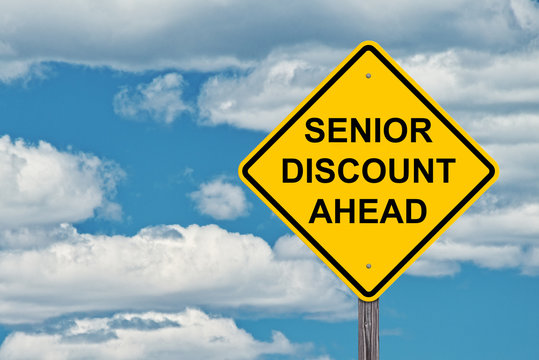 Caution Sign Blue Sky - Senior Discounts Ahead