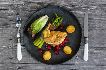 Chicken supreme with asparagus in prosciutto