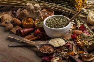 Bunch of healing herbs on wooden board. Herbal medicine. Top view.