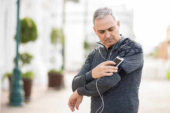 Mature man choosing a son for workout in city
