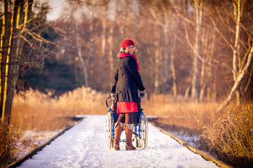 young woman running the wheelchair in the park