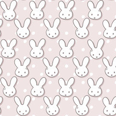 Seamless pattern with cute rabbit muzzles and polka dots