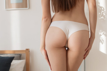 Perfect female sexy buttocks isolated.
