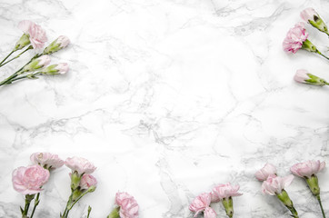 carnations flowers on a marble table