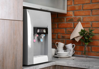 Modern water cooler on kitchen counter