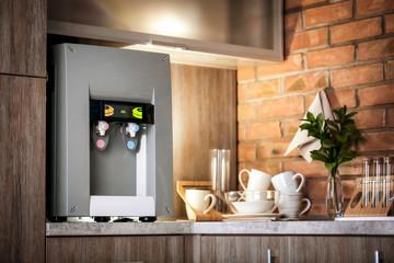 Modern water cooler on kitchen counter
