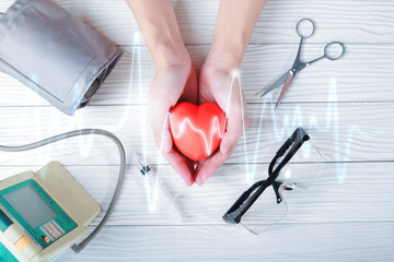 Hands holding red heart  with medical injection. medical concept