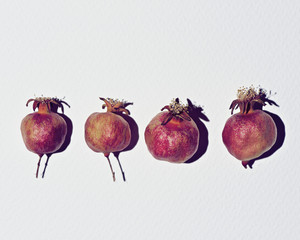 Overhead view of pomegranates on white table