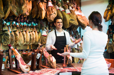 Brunette choosing iberico and serrano