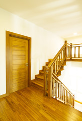 House interior with modern wooden staircase