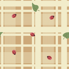 Pink pastel color tablecloth or napkin with cages, lines and bright red Ladybirds