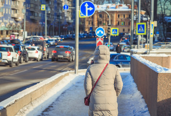 Back view. People on the streets of St. Petersburg in the winter