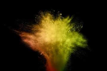 abstract explosion of orange dust  on black background. abstract orange  powder splatter on black  background. Freeze motion of orange  powder splash.