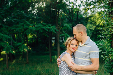 Horizontal portrait of a husband hugging his beautiful pregnant wife