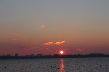 Sunset over the Zevenhuizerplas lake in Rotterdam Nesselande district