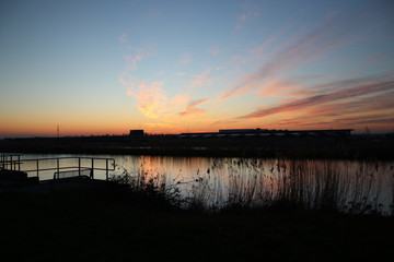 Sunset with variety of colors above river Rotte in Zevenhuizen, The Netherlands