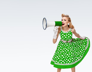 happy woman holding megaphone, dressed in pin-up style dress