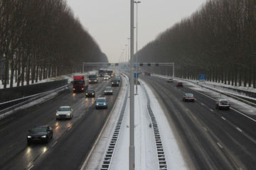 Traffic on a highway with snow in the Netherlands