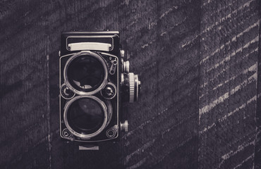 Old photo camera in black and white from above with copy space