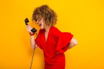 Attractive woman with short curly hair with phone