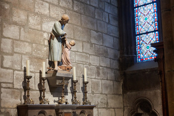 Architecture inside the Notre Dame Cathedral. The figure of Jesus