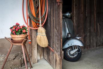 Fotorolgordijn Scooter Barn find of old, rusty italian scooter in a hut