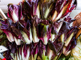 Red chicory in a pile for sale at a farmers market