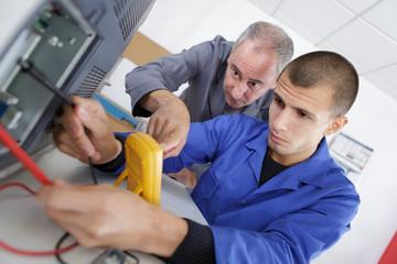 apprentice calibrating printer