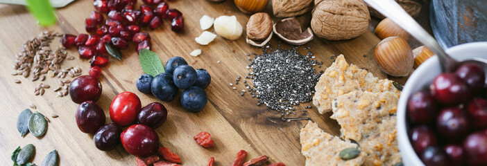 Superfood: various superfoods on wooden background